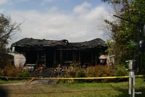 The house in the fire's aftermath.