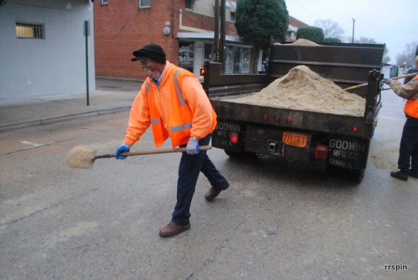 Public Works crews spread sand this morning.