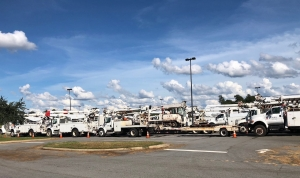 Bucket trucks line up at Roanoke Rapids Theatre staging area.