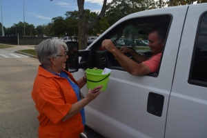 Sue Owens collects money from her son, Steve, during a roadside collection effort.