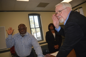 Pender, left, and Hines, are sworn in as McCollum awaits to be affirmed.