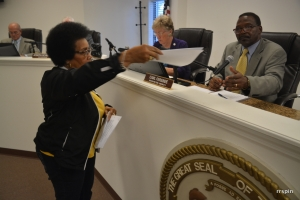 Ruby Mason hands Ferebee a petition.