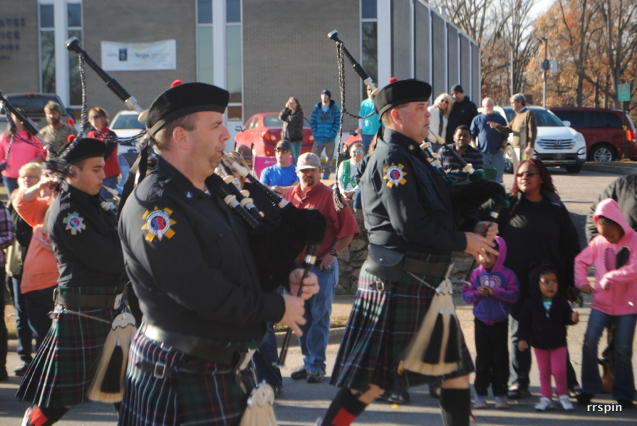The Greenville Public Safety Pipes & Drums marches down the avenue.